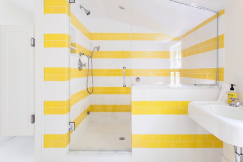 Yellow And White Striped Tile Bathroom